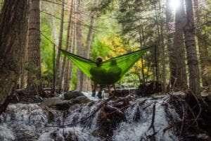 Couple feeling good in a hammock.